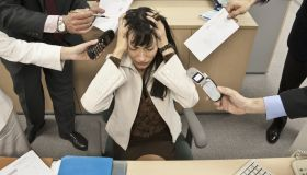 Business people bothering stressed businesswoman
