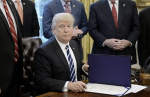 President Trump Signs A Resolution Related To Financial Reform