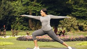 Young woman doing yoga at park
