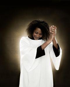 A gospel singer clapping